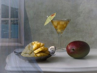 Still life with mango and cocktail