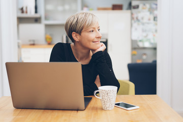 Woman relaxing in the office looking to the side