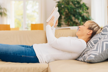 Woman spending a relaxing day reading a book