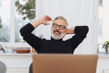 Satisfied businessman stretching his arms