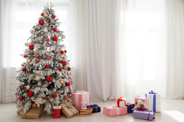 Christmas tree in a room with toys and gifts holiday new year winter postcard