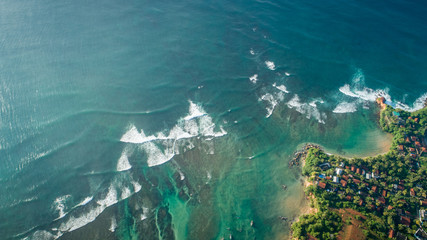 Beautiful aerial view of tropical coastline and fishman village
