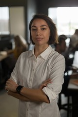Female executive looking at camera in office