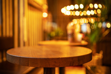 Picture of cafe interior with wooden table and chairs