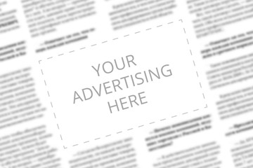 Close up of a copy space with wrtitten words Your Advertising Here on a blurred background of a newspaper. Business concept. Adding ad into paper page. Mockup of a newspaper advertisement column.