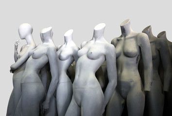 Isolated nude lifeless mannequins