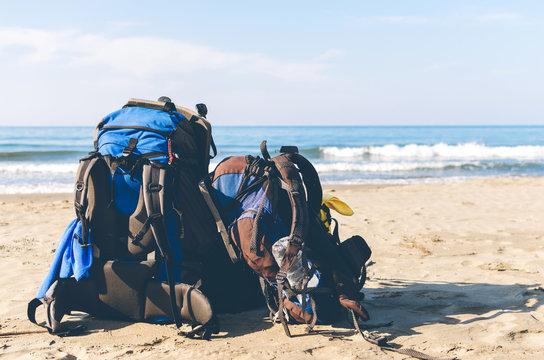 Hiking tourists backpack on the coastline