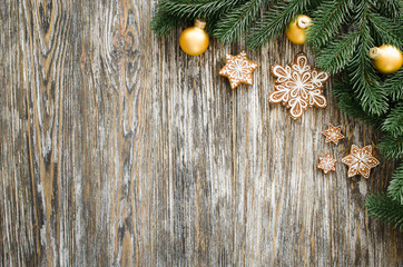 Christmas wooden background with fir tree and gingerbread