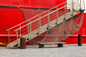 Red Boat with a Bridge Gangway