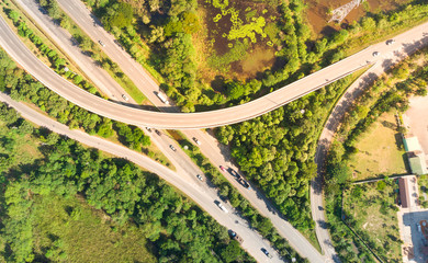 Aerial drone photo elevated toll road junction and interchange highway with forest
