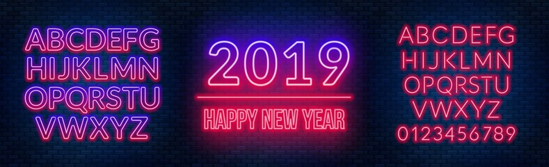 Neon sign happy new year on a dark background with bright alphabets.