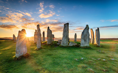 Stunning sunset over the Callanish stone circle on the Isle of Lwais in the Outer Hebrides of Scotland Wall mural