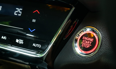 Engine start button with air control panal on Luxury caris a new technology used instead of starting the engine with keys in Transportation and safety concept.
