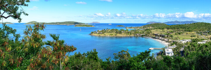 Panoramic landscape of tropical marine blue lagoon with wild green jungle in the foreground. High resolution