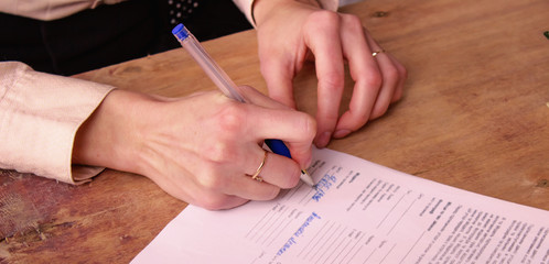 The girl signs an important document