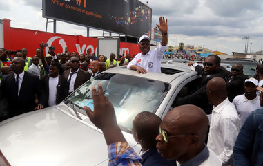 Congolese opposition presidential candidate Martin Fayulu waves to supporters as he arrives at the N'djili International Airport in Kinshasa