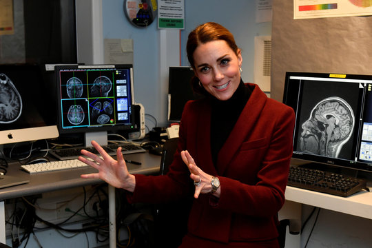 Britain's Catherine, Duchess of Cambridge gestures during a visit to a UCL Developmental Neuroscience Laboratory, in London