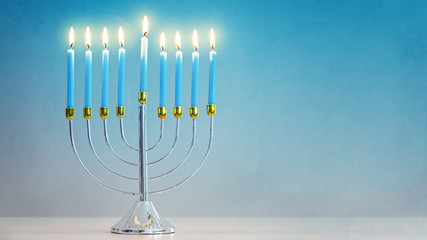 Illuminated Hanukkah Menorah Blue Background