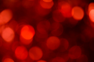 Bokeh. Holiday background. Christmas lights. Glitter. Defocused sparkles. New Year backdrop. Festive wallpaper. Blinks. Carnival. Bokeh retro style photo. Red.