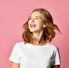 Emotional angry woman screaming shouting yelling closeup portrait on pink background