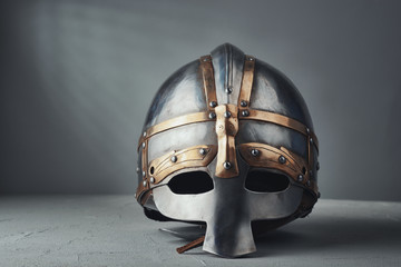 Knight's helmet on a gray background