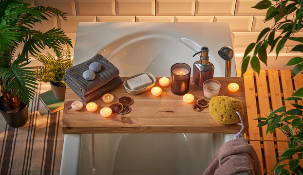 Modern spa tub beauty center candle soap and sauna flower decoration.