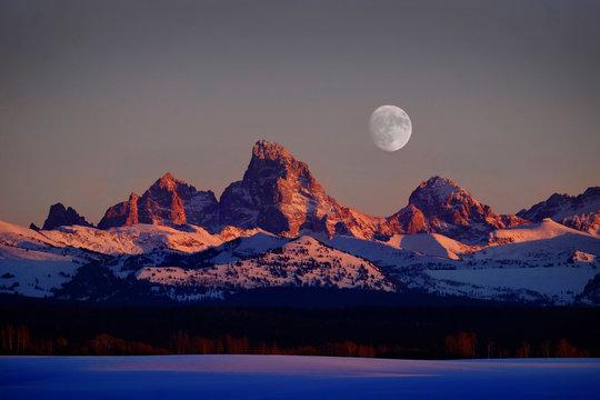 Sunset Light Alpen Glow on Tetons Teton Mountains wtih Moon Rising