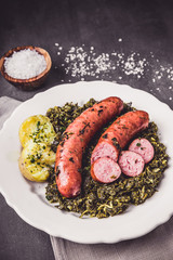 Kale with cooked sausage and potatoes