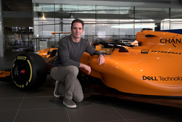 Nascar driver Jimmie Johnson poses for a photograph with an F1 car at the McLaren Technology Centre in Woking