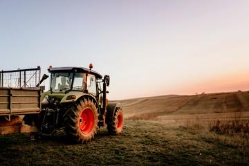 Farmer using modern tractor for harvesting