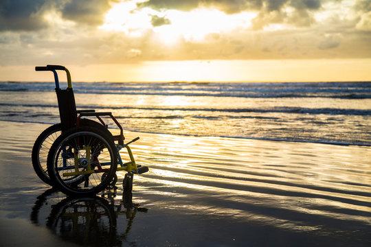 sunset childlike wheelchair horizon sand