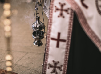 religious detail from orthodox church. Kandilo or cresset during liturgy