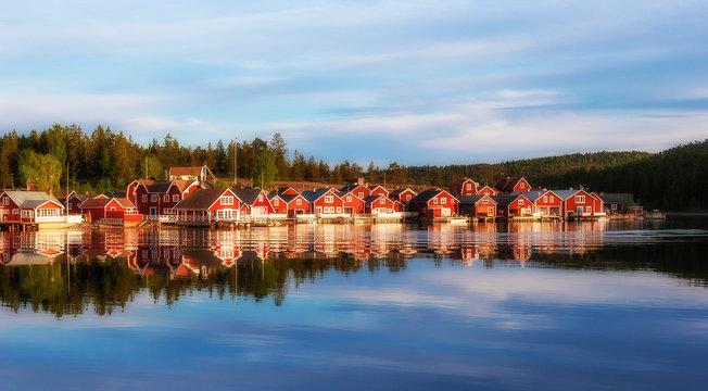 red houses at sunset in the  fishing village of Norfaellsviken, Höga Kusten, Sweden
