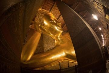 The largest golden  Reclinging Buddha in Wat Pho , Bangkok, Thailand.