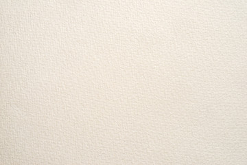 textured paper for watercolor painting. beige factured background, suitable as a backdrop for...