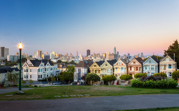 View of Painted Ladies at dusk, Victorian wooden houses, Alamo Square, San Francisco, California