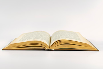 open book lying on a white background