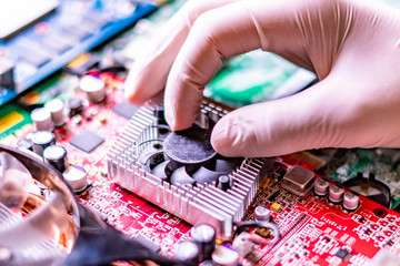hands attach and assembre the cooler fan to the videocard chip slot f