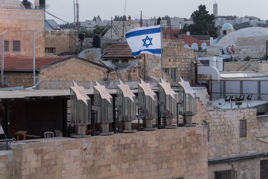 Israeli flag flying over Yizkor monument above the western wall in  Jerusalem,Israel