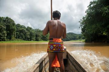 Indigenous Embera in boat crossing the river, Gamboa Panama