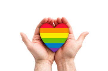 LGBT rainbow heart symbol of love in hands