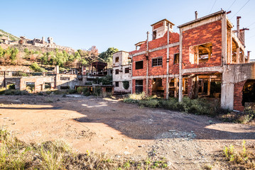 old abandoned mine on Sardinia, Italy. ruined industry architecture, europe