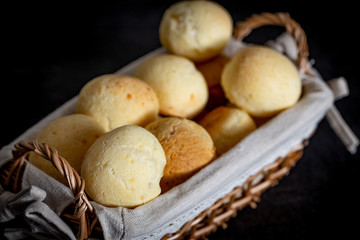 Brazilian homemade cheese bread, AKA 'pao de queijo' in a rustic basket.