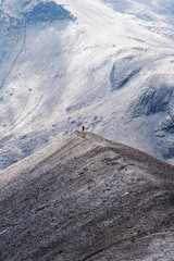 a man hikes over a ridge in the swiss alps, top of europe, schilthorn, switzerland.