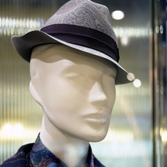Male mannequin head in hat