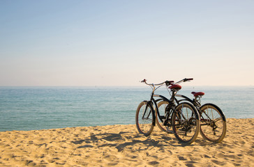 two bicycles on the beach