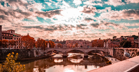 view of the Vittorio Emanuele II Bridge at sunset, with the Tiber, in Rome, Italy