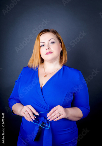 Beautiful Chubby Girl In Blue Elegant Dress On A Black Background Sexy Plus Size Woman