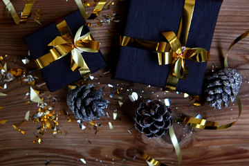 Flat lay photo with gifts and pine cones. Beautiful Christmas greeting card