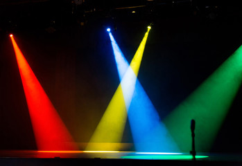 4 Colors spot lights shining through smoke on stage Red Yellow Blue Green
